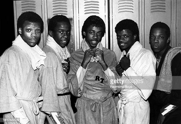 Singing group New Edition poses for photos at Screamin' Wheels Roller Rink in Gary Indiana in JANUARY 1984