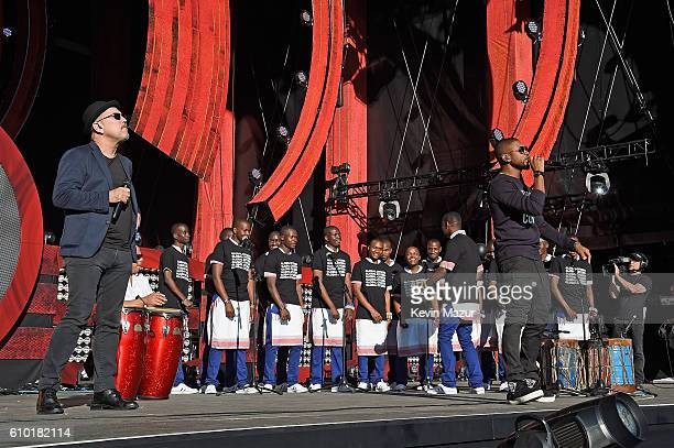 Singers Ruben Blades and Usher perform with the Kenyan Boys Choir onstage at the 2016 Global Citizen Festival In Central Park To End Extreme Poverty...