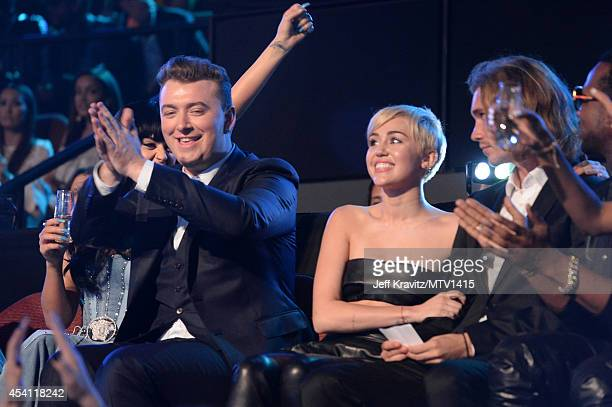 Singers Sam Smith Miley Cyrus and My Friend's Place representative Jesse Helt attend the 2014 MTV Video Music Awards at The Forum on August 24 2014...