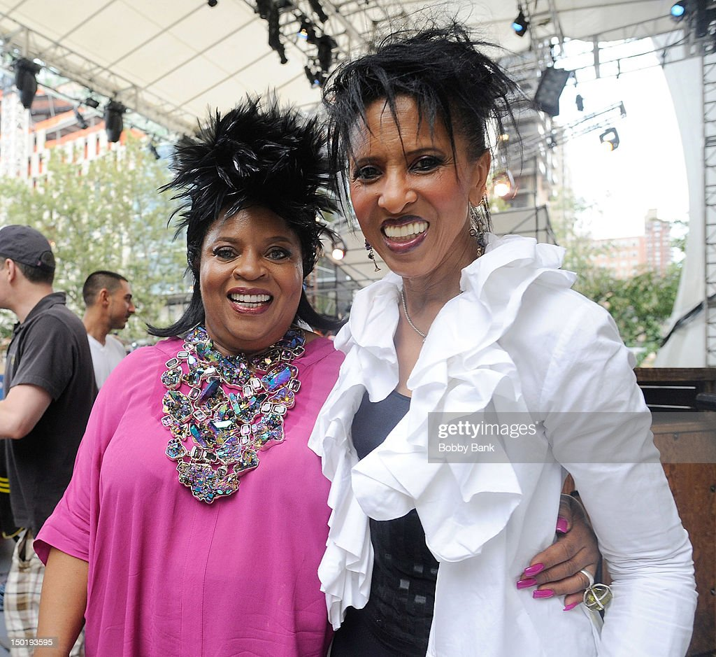Singers Sarah Dash and Nona Hendryx of Labelle backstage during the Triple Goddess Twilight Revue: Celebrating the Music Of Laura Nyro at Damrosch Park Bandshell on August 11, 2012 in New York City.