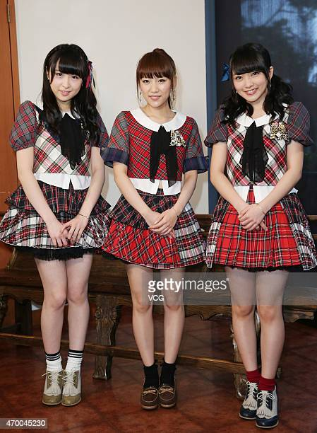 Singers Saya Kawamoto Mion Mukaichi and Minami Takahashi of Japanese girl group AKB48 meet fans on April 16 2015 in Taipei Taiwan