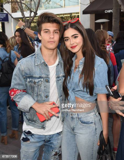 Singers Sean Cavaliere and Sammi Sanchez attend the GUESS x Peace Over Violence support Denim Day event at Third Street Promenade on April 26 2017 in...