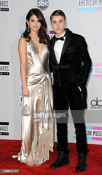 Singers Selena Gomez and Justin Bieber arrive at the American Music Awards in Los Angeles California on November 20 2011 AFP PHOTO/VALERIE MACON