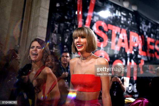 Singers Selena Gomez and Taylor Swift attend The 58th GRAMMY Awards at Staples Center on February 15 2016 in Los Angeles California