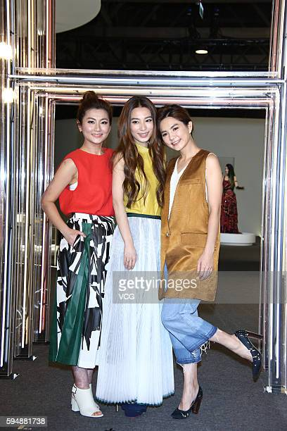 Singers Selina Hebe and Ella of SHE pose on a press conference to celebrate the 15th anniversary on August 24 2016 in Taipei Taiwan of China