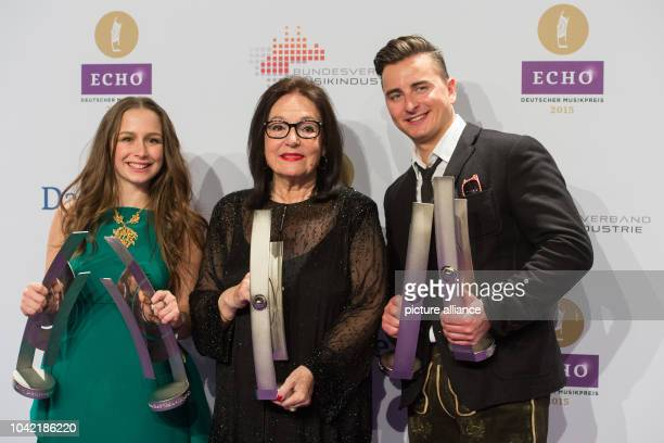 Singers SentaSofia Delliponti alias Oonagh Nana Mouskouri and Andreas Gabalier pose together with their awards after the Echo Music Awards ceremony...