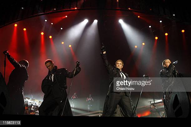 Singers Shane Filan Nicky Byrne Kian Egan and Mark Feehily of Westlife perform at Wembley Arena on March 28 2008 in London England