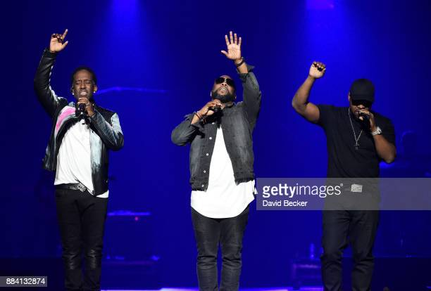 Singers Shawn Stockman Wanya Morris and Nathan Morris of Boyz II Men perform at the Vegas Strong Benefit Concert at TMobile Arena to support victims...