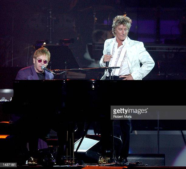 """Singers Sir Elton John and Rod Stewart perform """"Your Song"""" at the 7th Annual Andre Agassi Charitable Foundation's Grand Slam for Children benefit..."""