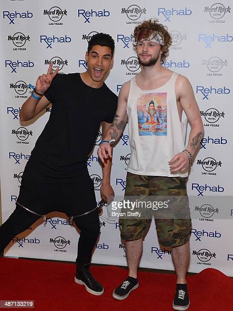 Singers Siva Kaneswaran and Jay McGuiness arrive at the Hard Rock Hotel Casino during the resort's Rehab pool party on April 27 2014 in Las Vegas...