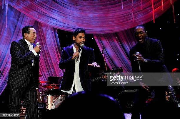 Singers Smokey Robinson Miguel and Aloe Blacc perform onstage at the PreGRAMMY Gala and Salute To Industry Icons honoring Martin Bandier at The...