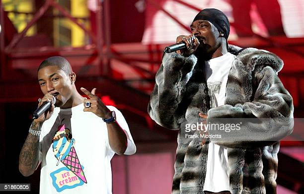 Singers Snoop Dogg and Pharrell perform onstage at the 2004 Spike TV Video Game Awards at Barker Hanger on December 14 2004 in Santa Monica California