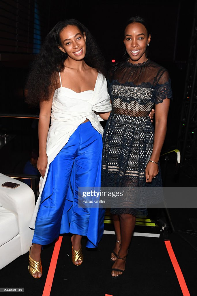Singers Solange Knowles and Kelly Rowland pose for a photo backstage at the 2016 ESSENCE Festival Presented By Coca-Cola at Ernest N. Morial Convention Center on July 3, 2016 in New Orleans, Louisiana.