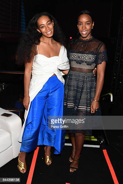 Singers Solange Knowles and Kelly Rowland pose for a photo backstage at the 2016 ESSENCE Festival Presented By CocaCola at Ernest N Morial Convention...