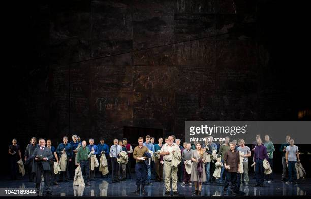 Singers stand on stage during a photo rehearsal of the opera 'Fidelio' of the State Opera at Schillertheatre in BerlinGermany 29 September 2016 The...