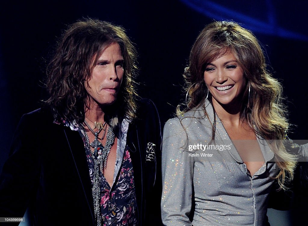 Singers Steven Tyler (L) and Jennifer Lopez appear onstage at a press conference to officially announce the season 10 'American Idol' judges panel at The Forum on September 22, 2010 in Inglewood, California.