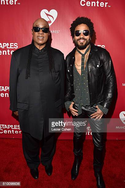 Singers Stevie Wonder and Lenny Kravitz attend the 2016 MusiCares Person of the Year honoring Lionel Richie at the Los Angeles Convention Center on...