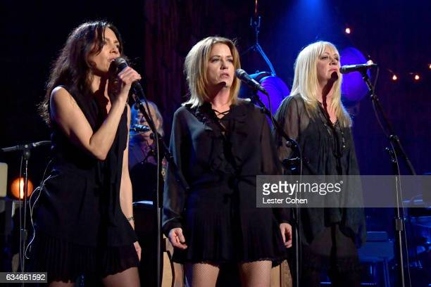 Singers Susanna Hoffs Vicki Peterson and Debbie Peterson of the Bangles perform onstage during MusiCares Person of the Year honoring Tom Petty at the...