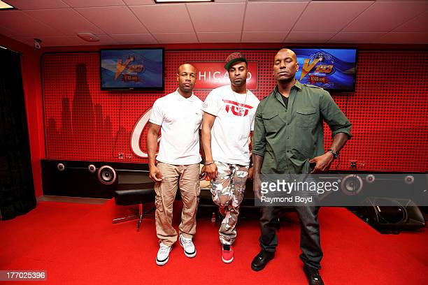 Singers Tank Ginuwine and Tyrese of the group TGT poses for photos in the V103FM CocaCola Lounge in Chicago Illinois on AUGUST 13 2013
