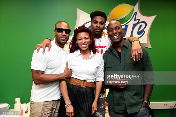 Singers Tank Ginuwine and Tyrese of the group TGT poses for photos with onair personality Consuella 'Connie' Williams in the V103FM 'CocaCola Lounge'...