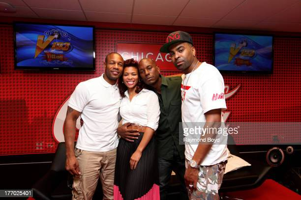 Singers Tank Ginuwine and Tyrese of the group TGT poses for photos with onair personality Consuella Connie Williams in the V103FM CocaCola Lounge in...
