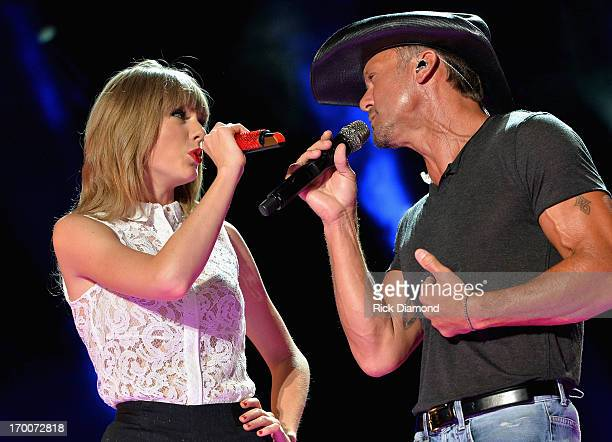 Singers Taylor Swift and Tim McGraw perform during the 2013 CMA Music Festival on June 6 2013 in Nashville Tennessee