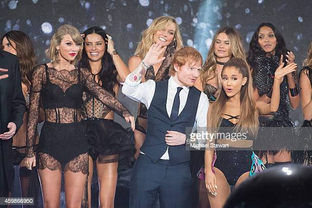 Singers Taylor Swift Ed Sheeran and Ariana Grande attend the annual Victoria's Secret fashion show at Earls Court on December 2 2014 in London England