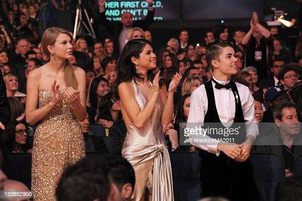Singers Taylor Swift Selena Gomez and Justin Bieber in the audience at the 2011 American Music Awards held at Nokia Theatre LA LIVE on November 20...
