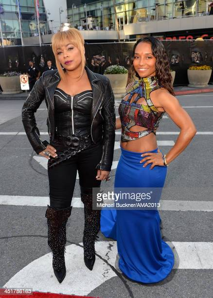 Singers TBoz and Chili of TLC attend the 2013 American Music Awards at Nokia Theatre LA Live on November 24 2013 in Los Angeles California