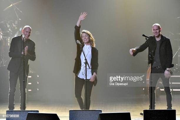 Singers Tim Hanseroth Brandi Carlile and Phil Hanseroth perform onstage during MusiCares Person of the Year honoring Fleetwood Mac at Radio City...