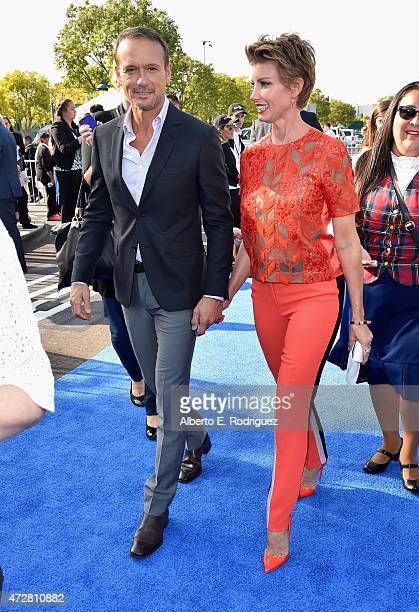 Singers Tim McGraw and Faith Hill attend the world premiere of Disney's Tomorrowland at Disneyland Anaheim on May 9 2015 in Anaheim California