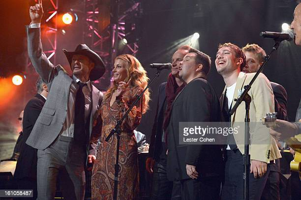 Singers Tim McGraw and Faith Hill musicians Sting and Ken Casey and honoree Bruce Springsteen perform onstage at MusiCares Person Of The Year...