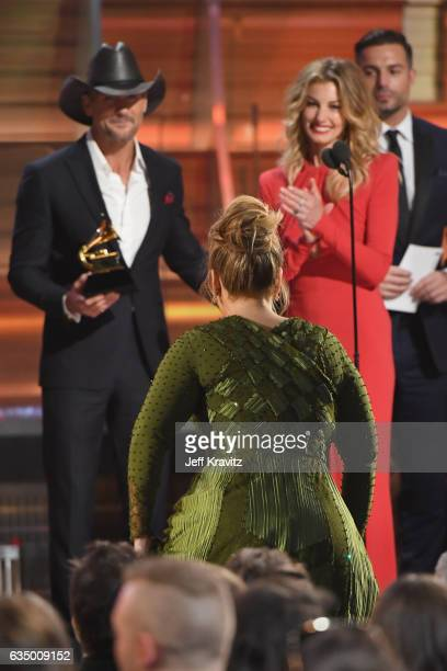 Singers Tim McGraw and Faith Hill present the Record of the Year award for 'Hello' to singer Adele onstage during The 59th GRAMMY Awards at STAPLES...