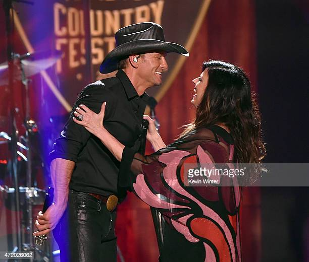 Singers Tim McGraw and Karen Fairchild of Little Big Town performs onstage during the 2015 iHeartRadio Country Festival at The Frank Erwin Center on...
