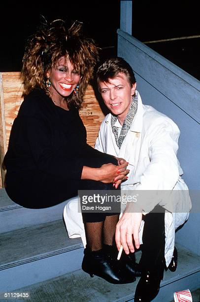 Singers Tina Turner and David Bowie backstage at the Birmingham NEC