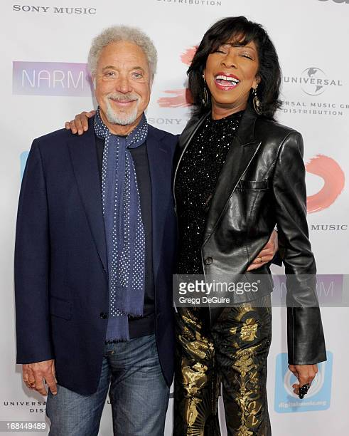 Singers Tom Jones and Natalie Cole arrive at the NARM Music Biz Awards dinner party at the Hyatt Regency Century Plaza on May 9 2013 in Century City...