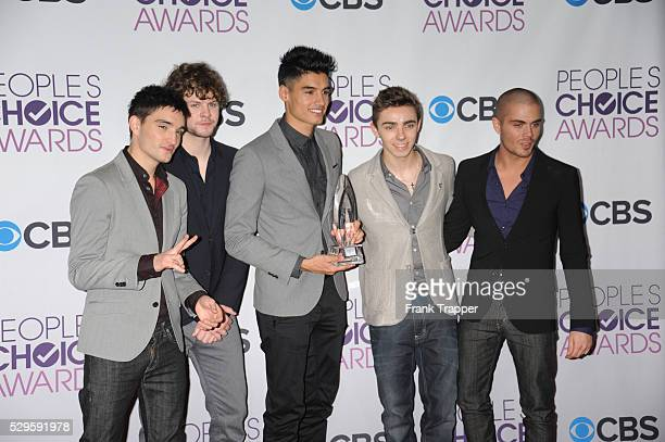 Singers Tom Parker Jay McGuiness Siva Kaneswaran Nathan Sykes and Max George of The Wanted winners of Favorite Breakout Artist pose in the press room...