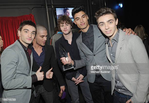 Singers Tom Parker Max George Jay McGuiness Siva Kaneswaran and Nathan Sykes of The Wanted attend the 39th Annual People's Choice Awards at Nokia...