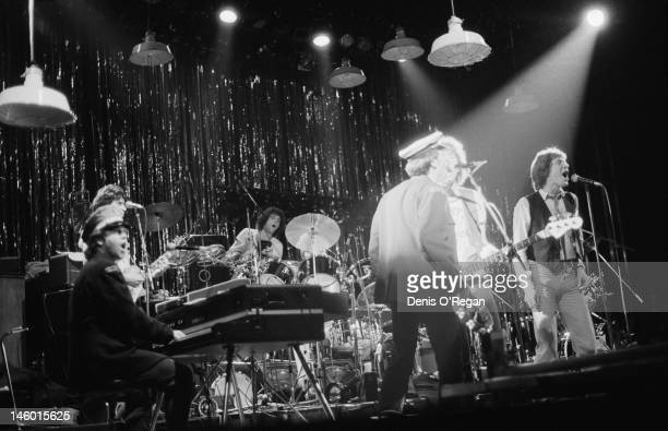 Singers Tom Robinson Peter Gabriel and Elton John performing at the Hammersmith Odeon in London during the Rob Gab Xmas charity show 24th December...