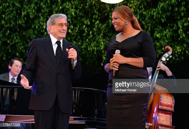 Singers Tony Bennett and Queen Latifah perform during the 87th birthday celebration of Tony Bennett and fundraiser for Exploring the Arts the charity...