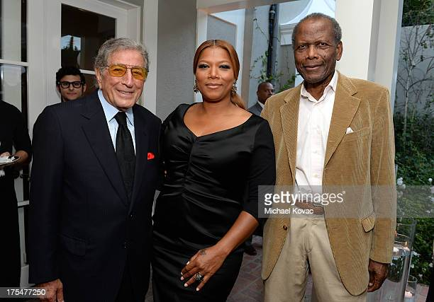 Singers Tony Bennett Queen Latifah and actor Sidney Poitier attend the 87th birthday celebration of Tony Bennett and fundraiser for Exploring the...