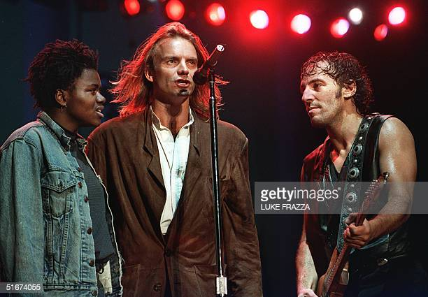 Singers Tracy Chapman, Sting, and Bruce Springsteen perform at the Amnesty International benefit concert at JFK Stadium in Philadelphia, Pennsylvania...