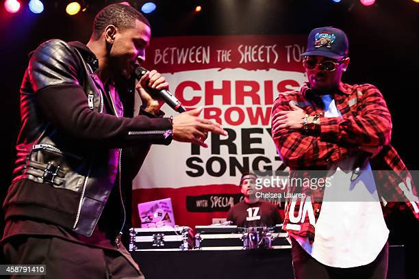Singers Trey Songz and Chris Brown attend a press conference at House of Blues Sunset Strip on November 10 2014 in West Hollywood California