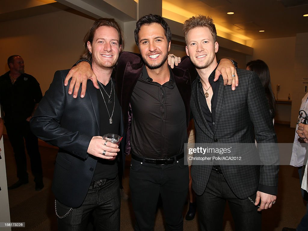 Singers Tyler Hubbard (L) and Brian Kelley (R) of Florida Georgia Line and singer Luke Bryan (C) attend the 2012 American Country Awards at the Mandalay Bay Events Center on December 10, 2012 in Las Vegas, Nevada.