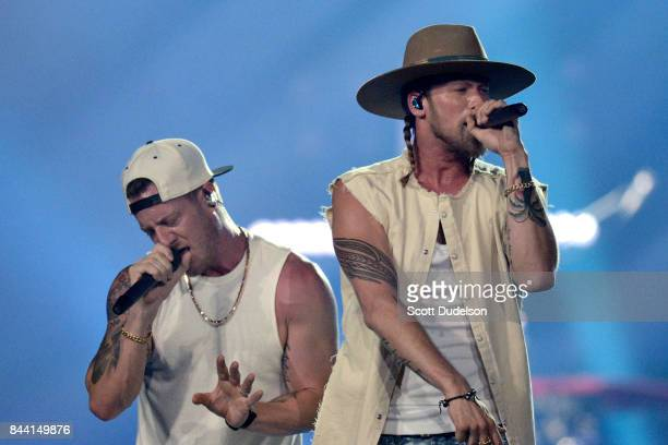 Singers Tyler Hubbard and Brian Kelley of Florida Georgia Line perform onstage during the Smooth World Tour at Honda Center on September 7 2017 in...