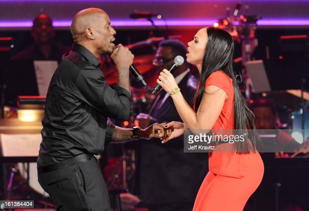 Singers Tyrese and Elle Varner perform onstage during the 55th Annual GRAMMY Awards at Nokia Theatre on February 10 2013 in Los Angeles California
