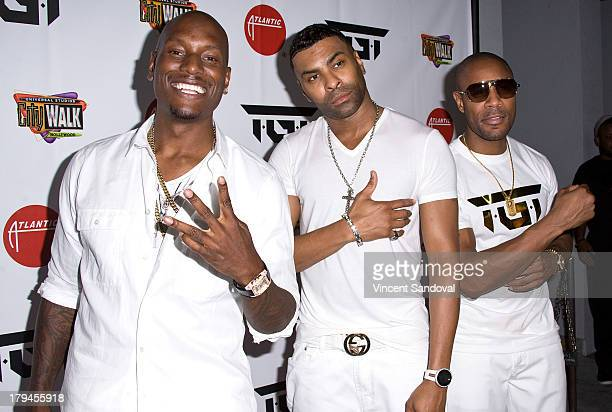 Singers Tyrese Gibson Ginuwine and Tank attend the TGT 5 Towers performance at Universal CityWalk on September 3 2013 in Universal City California