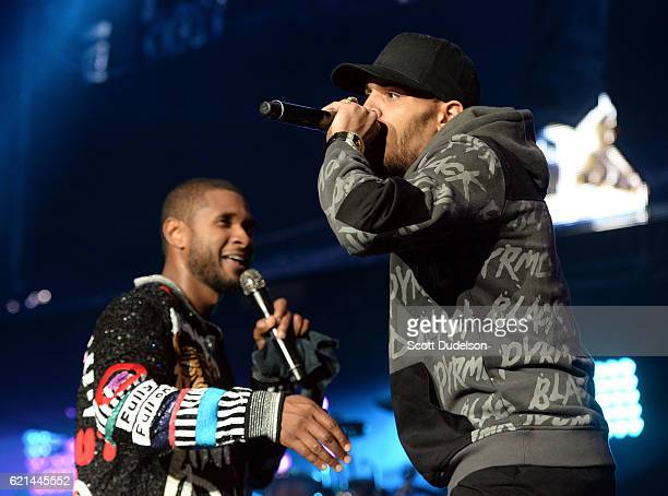 Singers Usher and Chris Brown perform onstage during the 923 Real Show at The Forum on November 5 2016 in Inglewood California
