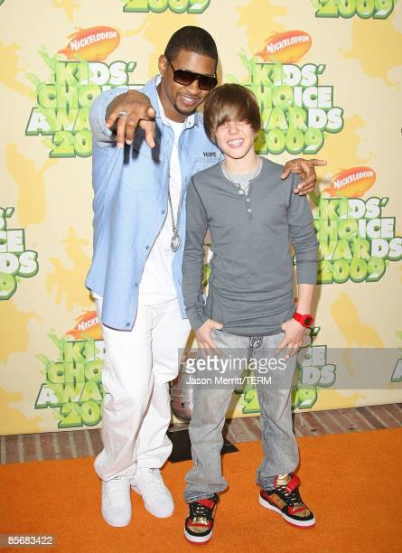 Singers Usher and Justin Bieber arrive at Nickelodeon's 2009 Kids' Choice Awards at UCLA's Pauley Pavilion on March 28 2009 in Westwood California