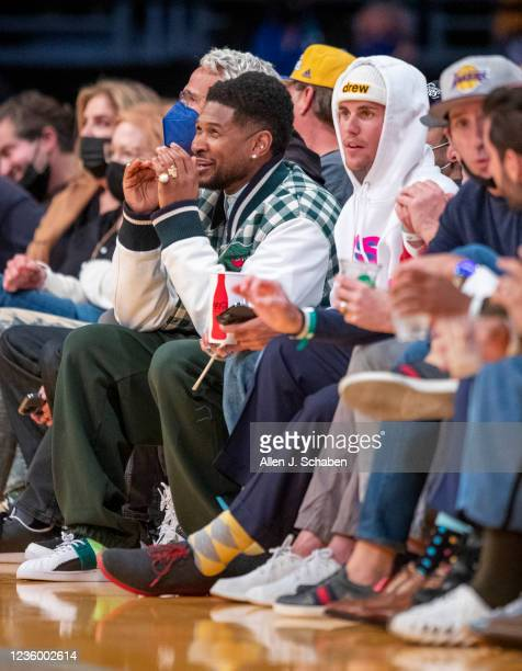 Singers, Usher and Justin Bieber attends a game between the Golden State Warriors and the Los Angeles Lakers on October 19, 2021 at Staples Center in...